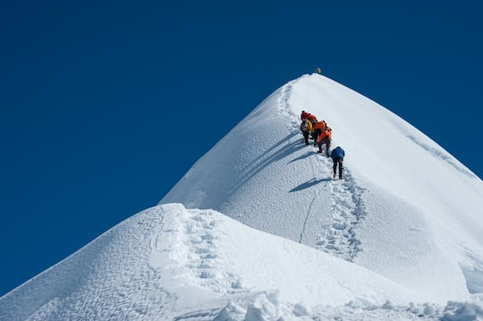 Climbers approach the summit.